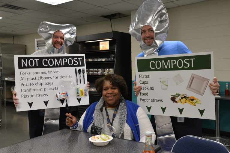 Jack Lyon, General Manager of Centerplate at the New Orleans Ernest N. Morial Convention Center (Left) and Adam Straight, VP of Operations at the New Orleans Ernest N. Morial Convention Center (Right) dressed as spoons to illustrate the importance of composting with Jocelyn Williams, Centerplate Vault Supervisor (Center) during the Employee Education Event