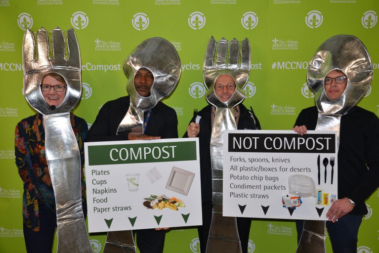 (From left to right) Linda Baynham, New Orleans Ernest N. Morial Convention Center Director of Sustainability and Corporate Social Responsibility; Sean Jackson, Electrical Foreman, New Orleans Ernest N. Morial Convention Center; Brian Dupree Sr., Chief Electrician; and Brian Benadom of Centerplate dressed as spoons and forks to educate employees on how to dispose of their lunch waste