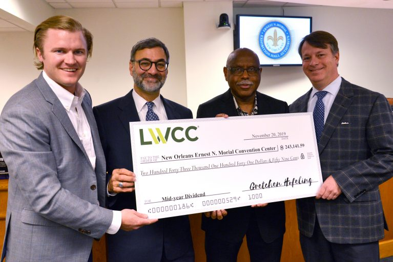 Seth Irby, Chief Marketing & Customer Experience Officer of LWCC presents a dividend check to New Orleans Ernest N. Morial Convention Center President Michael Sawaya,  New Orleans Ernest N. Morial Exhibition Hall Authority Commissioner Ronald Guidry, and Authority Chairman Melvin Rodrigue.